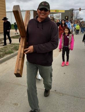 Paul Hardy carries the cross.