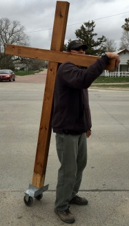 Paul Hardy braces the cross while the group prays.