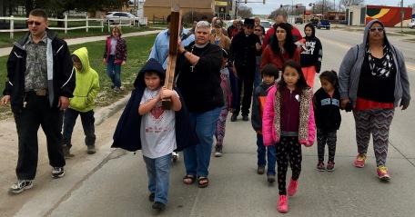 Danny Gangone carries the cross with Mother Lauren.
