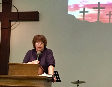 Pastor Cindi Lester, who organized the walk, starts off the preaching.