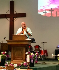 Pastor Jack Moore preaches.